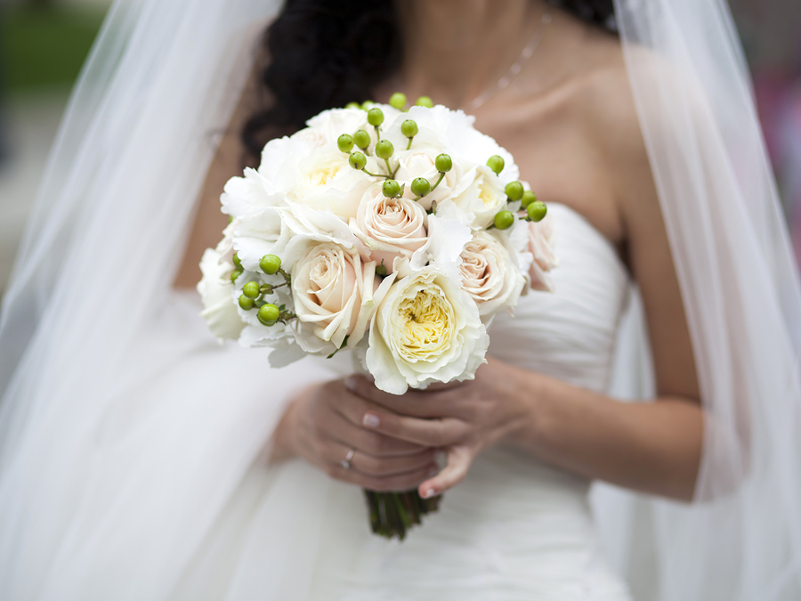 Bride holding beautiful white wedding bouquet