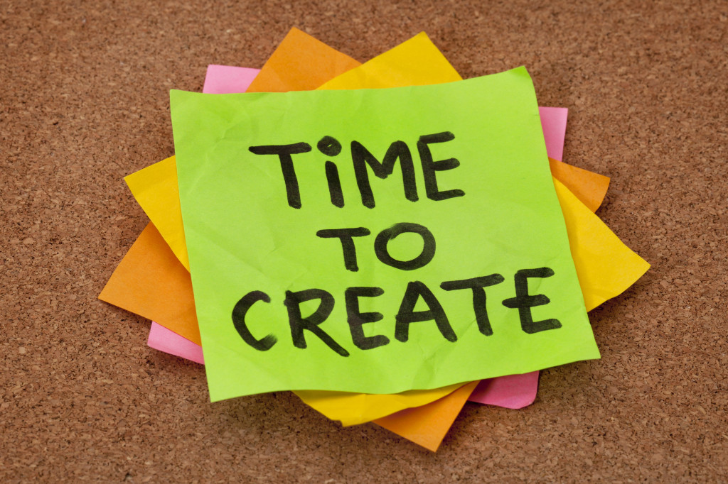 creativity concept - time to create reminder on a stack of stick