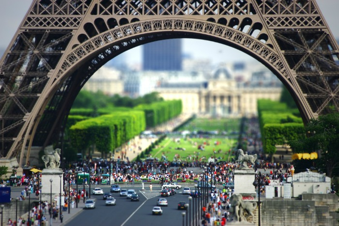 A tilt-shift photograph of the Eiffel Tower