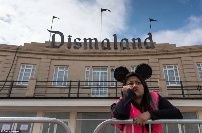 Employee looking bored at Banksy's Dismaland