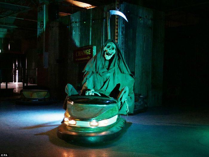 Grim reaper driving dodgem at Banksy's Dismaland